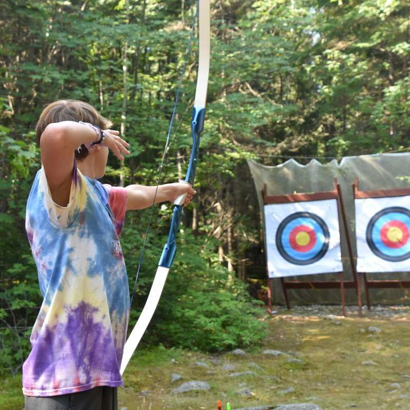 Camper at archery, aiming at the target at Canadian Adventure Camp