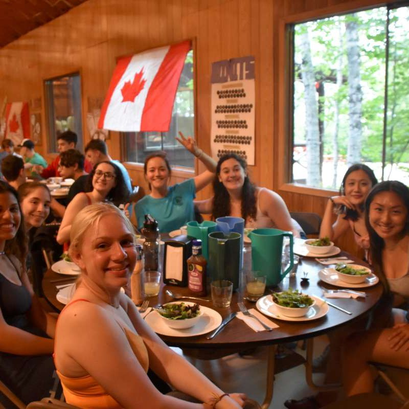 Cabin group sitting together during dinner at Canadian Adventure Camp