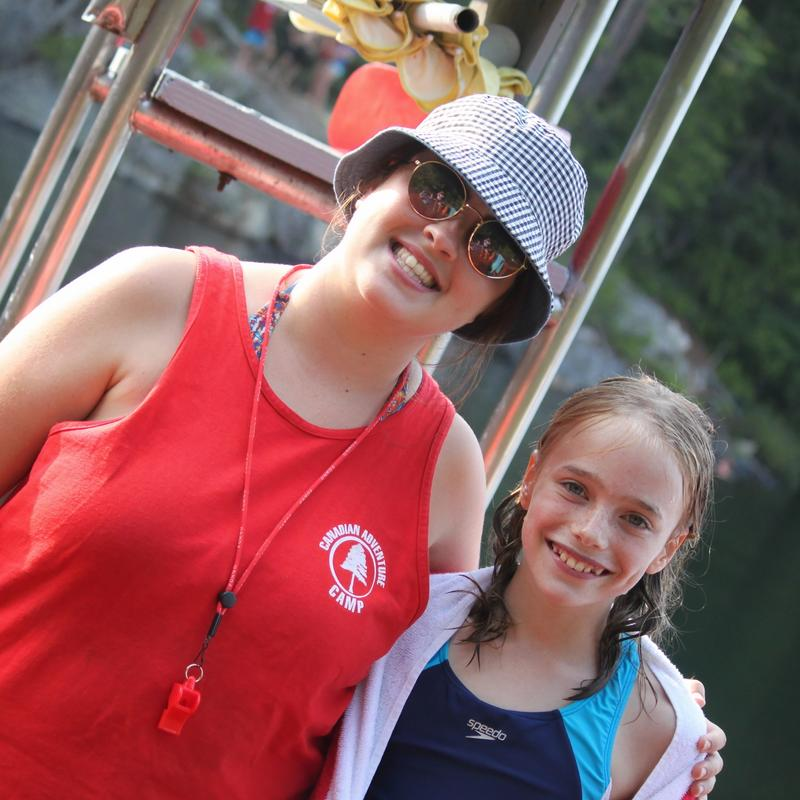 lifeguard, camp nurse smiling with a camper at Canadian Adventure Camp