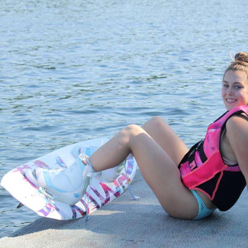 Camper wake-boarding on the lake.