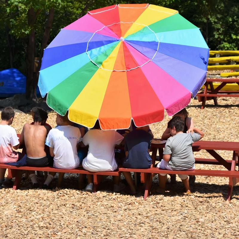 Flintstone field area of camp, campers sitting talking together at Canadian Adventure Camp