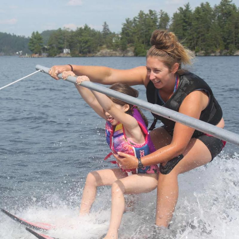 waterski coach with young camper