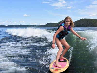 camper wakesurfing on the lake at Canadian Adventure Camp
