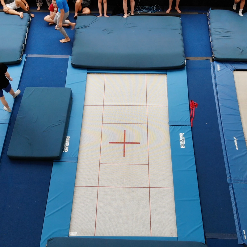 view from above of three trampolines with campers preparing to train on them
