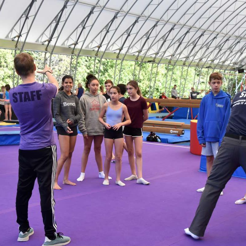 coaches and athletes in the gym during NCCP courses at Canadian Adventure Camp