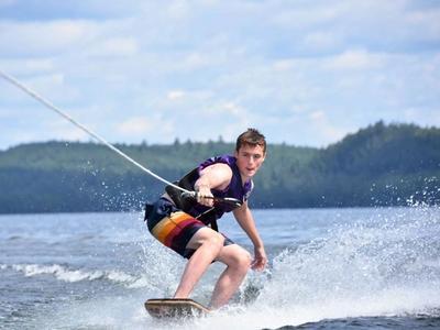 teenage camper wakeboarding at Canadian Adventure Camp