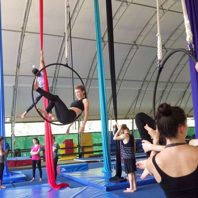 Campers on the silks and hoops training in the aerials program at Canadian Adventure Camp