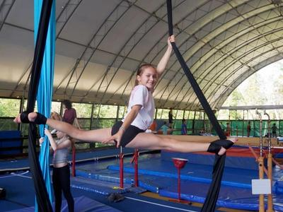 camper on the silks in the aerials program at Canadian Adventure Camp