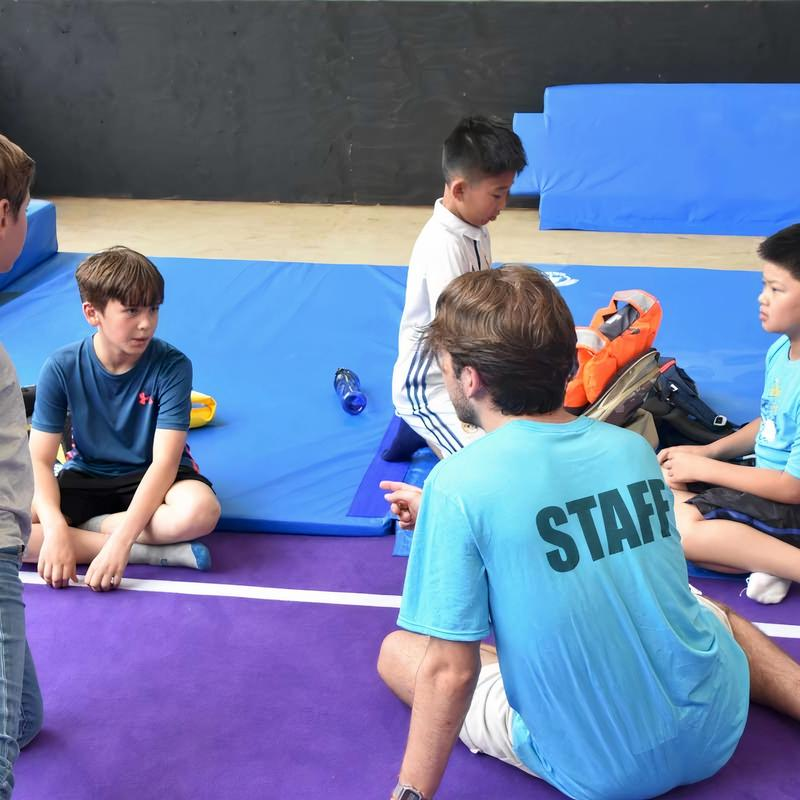 counsellor talking with group of campers at Canadian Adventure Camp