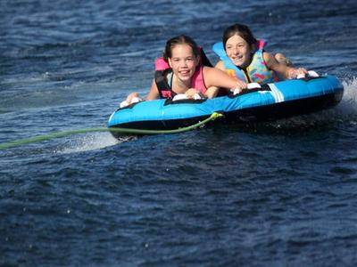 two young campers tubing on Lake Temagami at Canadian Adventure Camp
