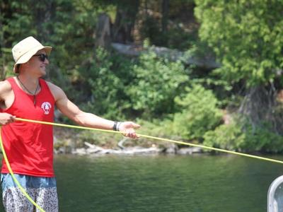 camp lifeguard pulling a boat in at Canadian Adventure Camp