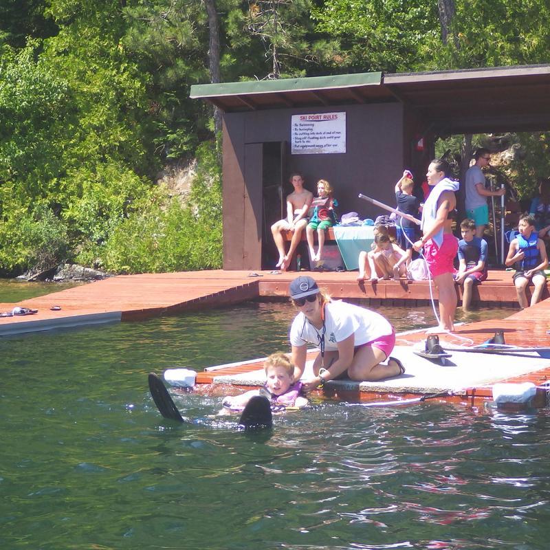 waterski coach teaching a camper in the waterski program at Canadian Adventure Camp