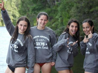 teenage girl campers smiling together at Canadian Adventure Camp