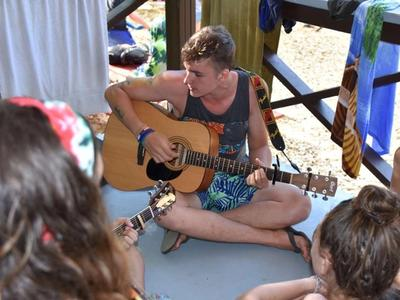 camp counsellor playing the guitar at Canadian Adventure Camp