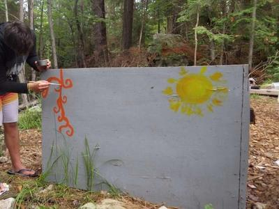camper painting mural with sunshine