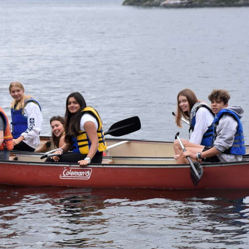 Senior campers canoeing on the lake.