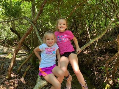 online summer camp siblings smiling at the camera