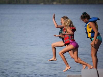 campers jumping into the lake at Canadian Adventure Camp