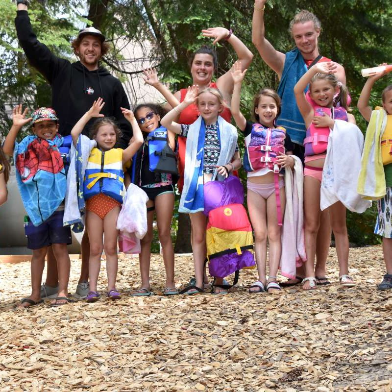 Group of campers and staff waving at the camera at Canadian Adventure Camp