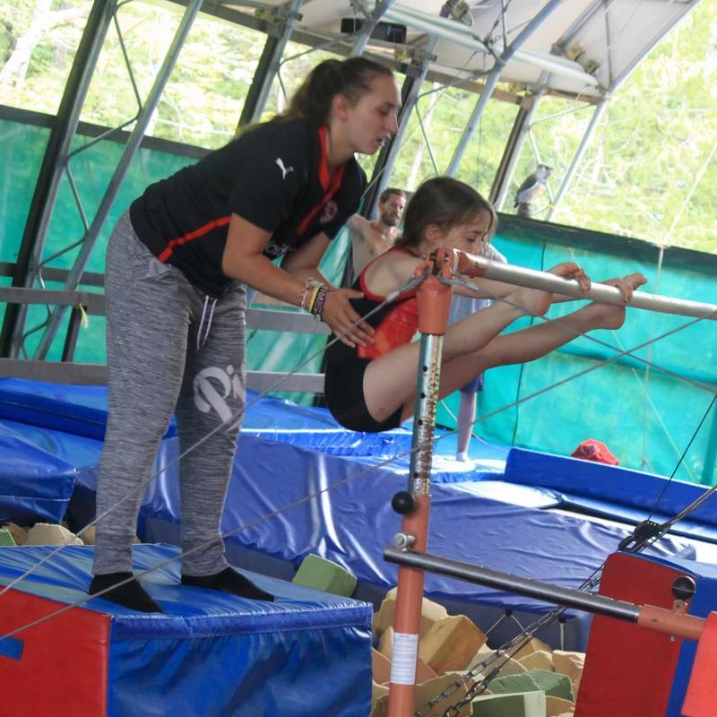 gymnastics coach training a camper at Canadian Adventure Camp