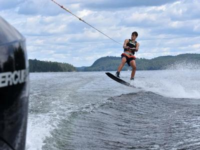 camper wakeboarding on the lake at Canadian Adventure Camp