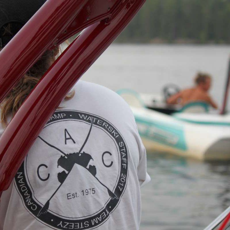 waterski coach sitting on a boat at Canadian Adventure Camp