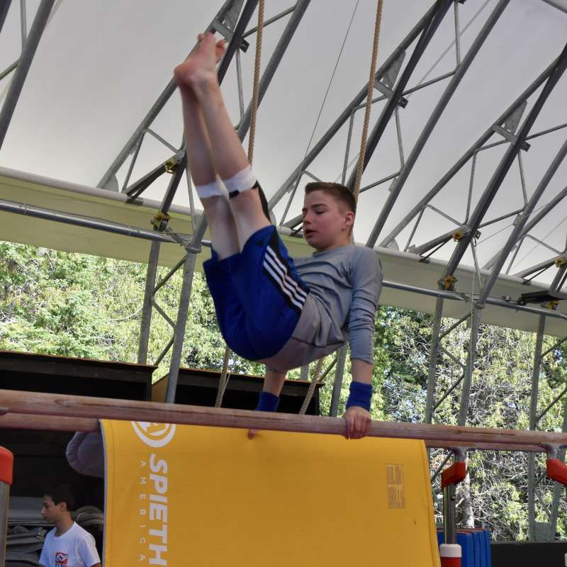 Camper practicing on parallels in the Specialty Gymnastics Program.
