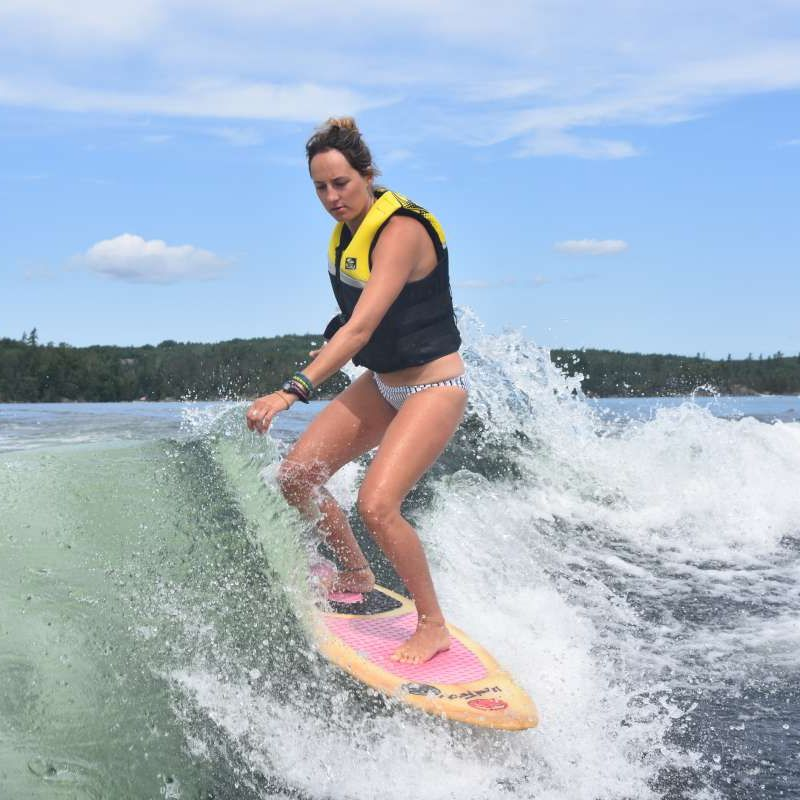 adult camper wakeboarding on the lake at Canadian Adventure Camp