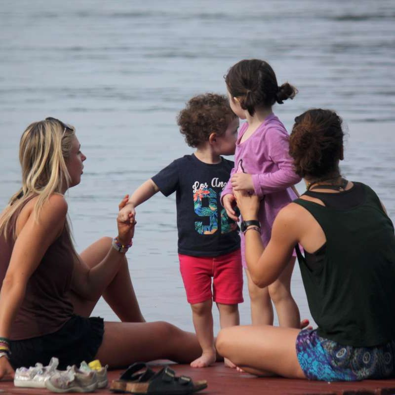 two camp nannies with young children on the dock at Canadian Adventure Camp