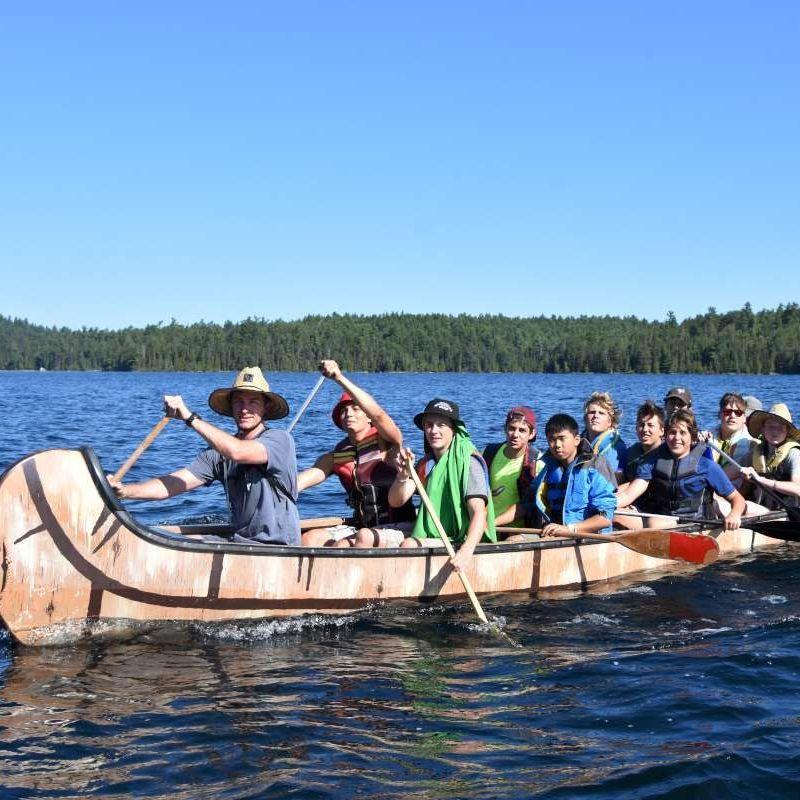 staff and cmapers on a canoe, on LKa
