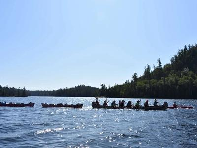 war canoe on the lake at Canadian Adventure Camp