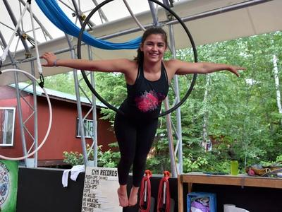 camper on the hoop in the aerials program at Canadian Adventure Camp