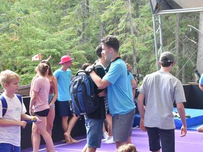 camper arriving at camp and meeting their counsellor