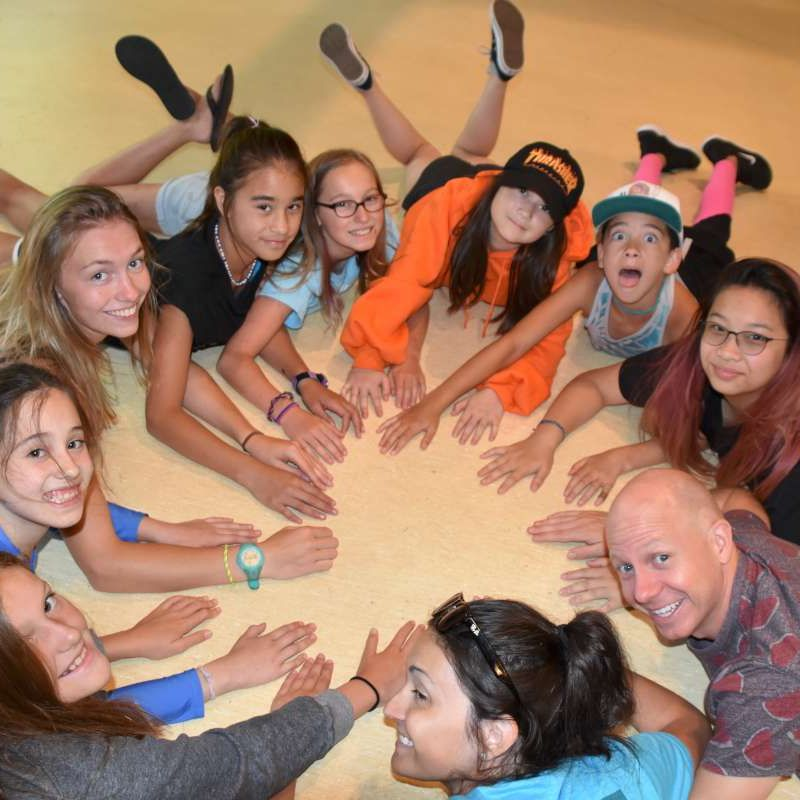 campers in a circle smiling at the camera at Canadian Adventure Camp