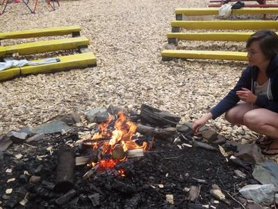 staff lighting a campfire at Canadian Adventure Camp