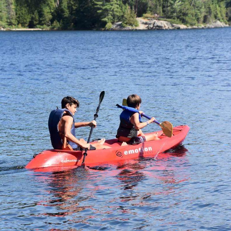 Two campers kayaking on Lake Temagami.