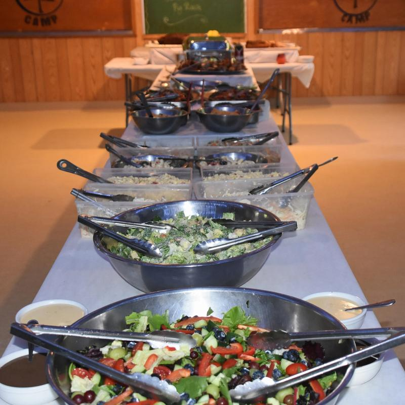 buffet food laid out on a table for a banquet dinner at Canadian Adventure Camp