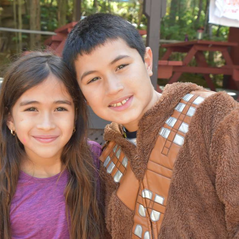 two siblings from Mexico smiling at Canadian Adventure Camp