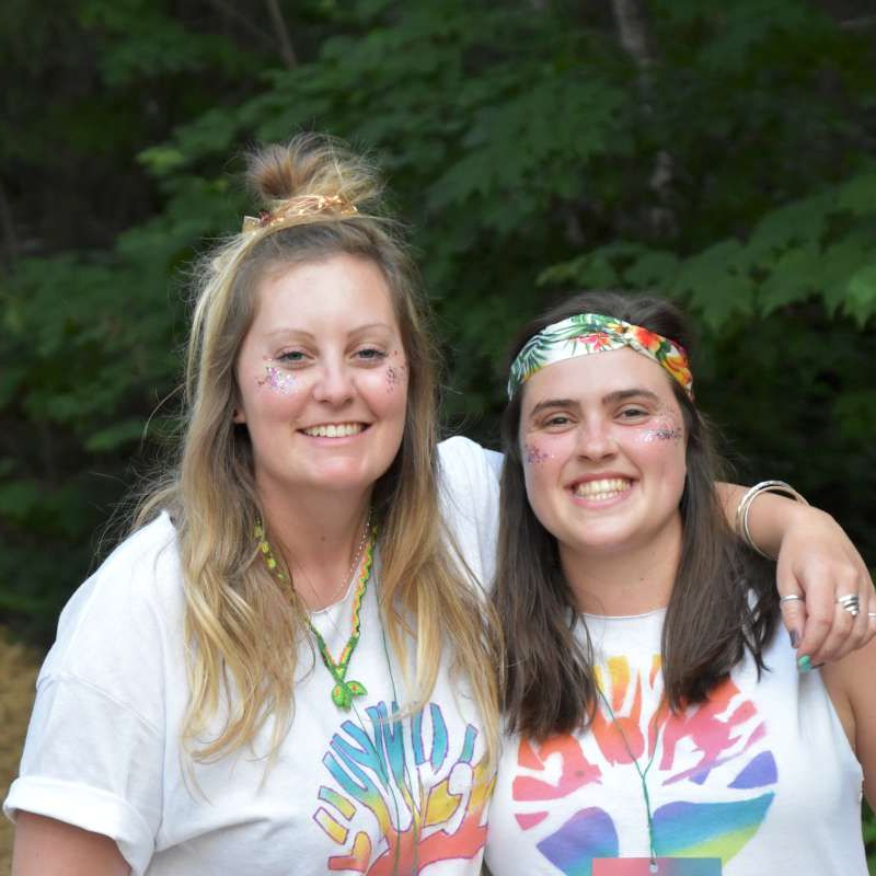 two alumni smiling at the camera at Canadian Adventure Camp