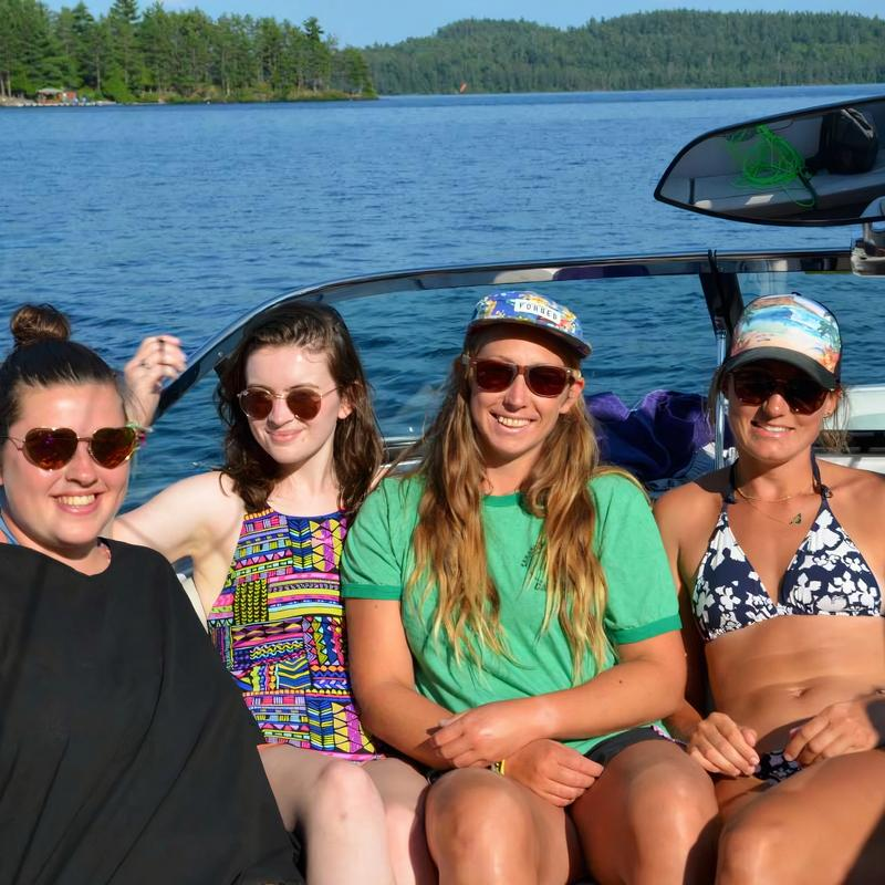 Group of staff on a boat smiling at the camera
