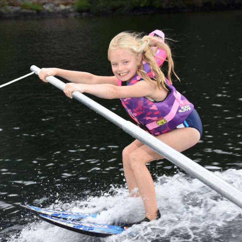 young camper trying waterskiing for the first time at Canadian Adventure Camp