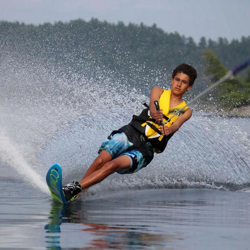 Boy camper waterskiing on the lake at Canadian Adventure Camp