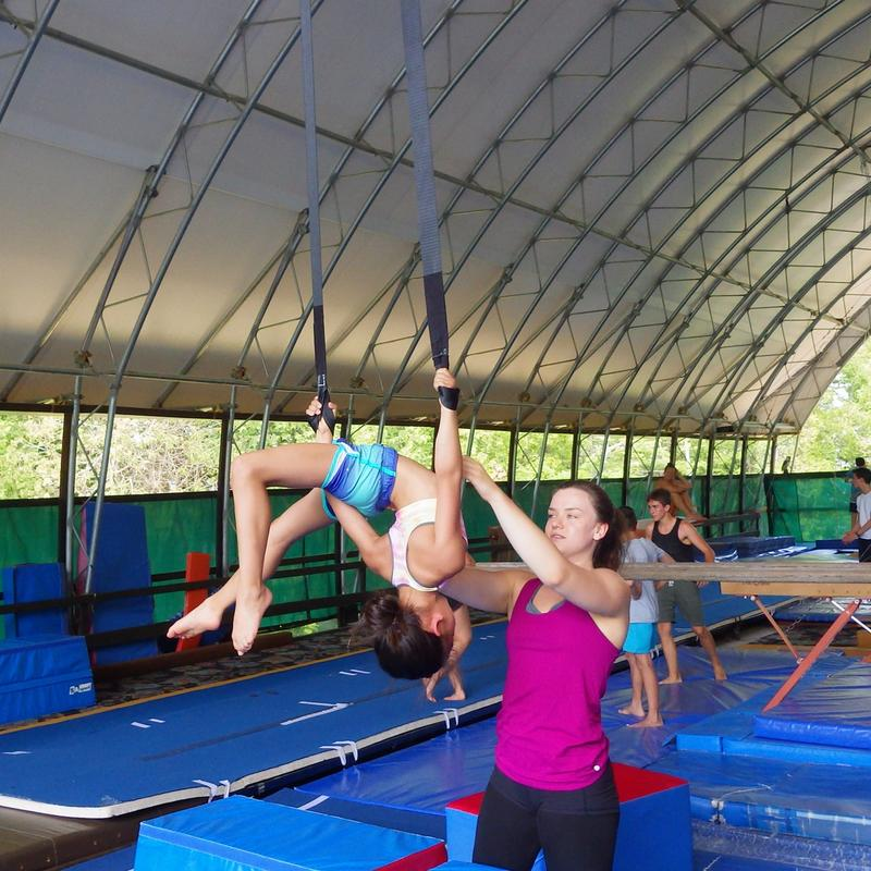 aerials coach with a camper in the gym at Canadian Adventure Camp