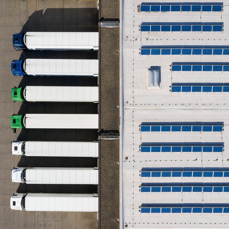 Mainspring aerial of trucks at building