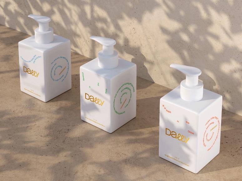 Three white Dally soap dispensers on a concrete wall.