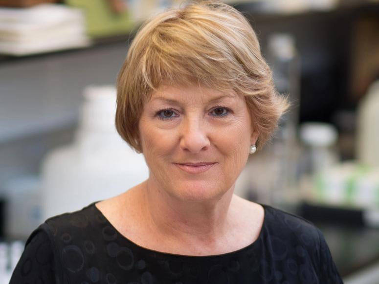Dr. Pamela Dalton against a blurry background.