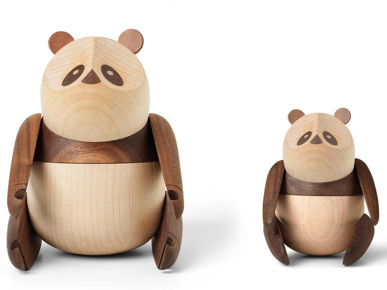 Two wooden pandas—one small, one large.
