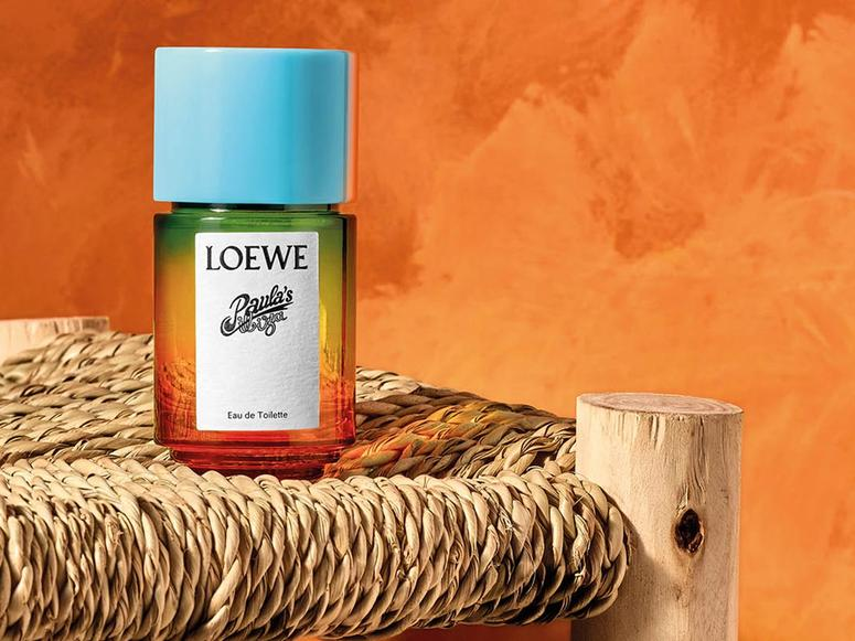 A bottle of Loewe perfume on a straw chair