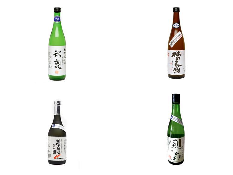 Four sake bottles on a white background.