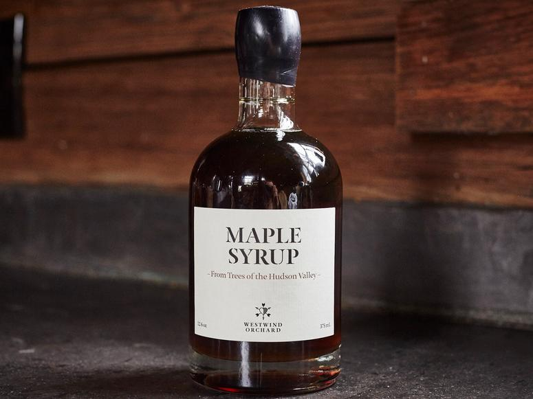 A bottle of Westwind Orchard maple syrup.